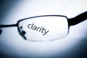 "Word ""clarity"" viewed from a glasses."
